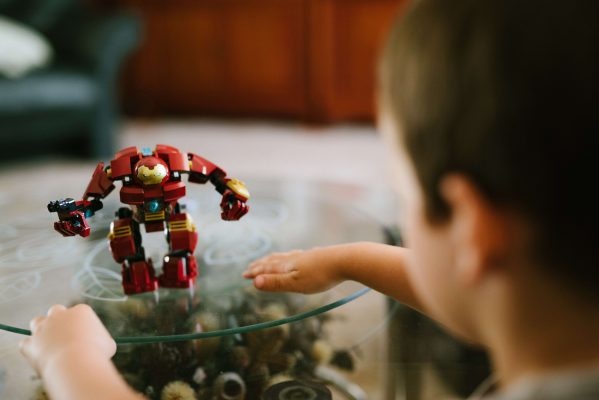 How To Get A Stylish, Yet Kid-Friendly Living Room - Glass Coffee Table With Child's Transformer Toy