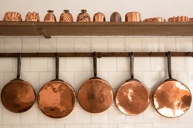 4 Easy Ways To Brighten Up Interiors - Copper Sauce Pans & Pots - Image By Stux