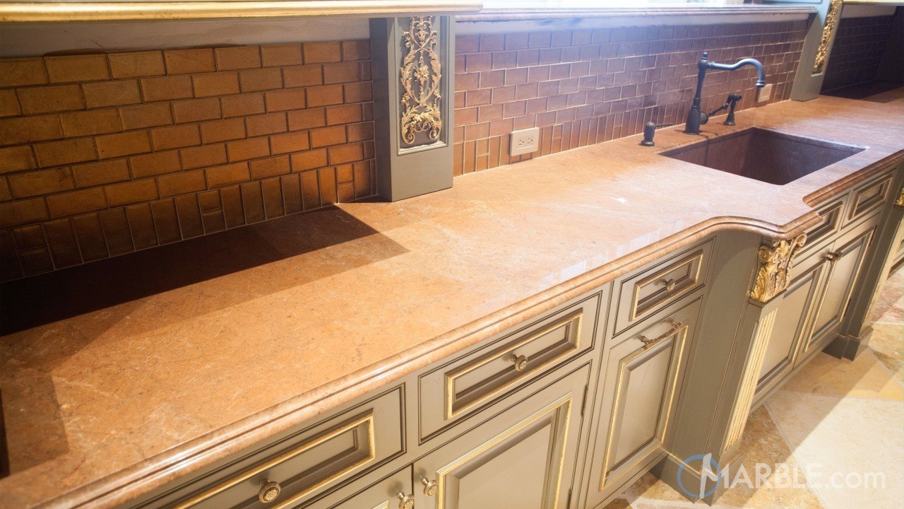 Guide To Purchasing A Countertop - Breccia Montana Quartzite with a Custom Stone Sink - Image Via marble.com