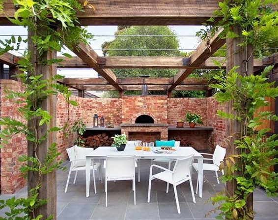 Summer Trends To Make Your Garden Stand Out - Vine Covered Pergola Entertaining Area With Pizza Oven Design Ian-Barker Gardens