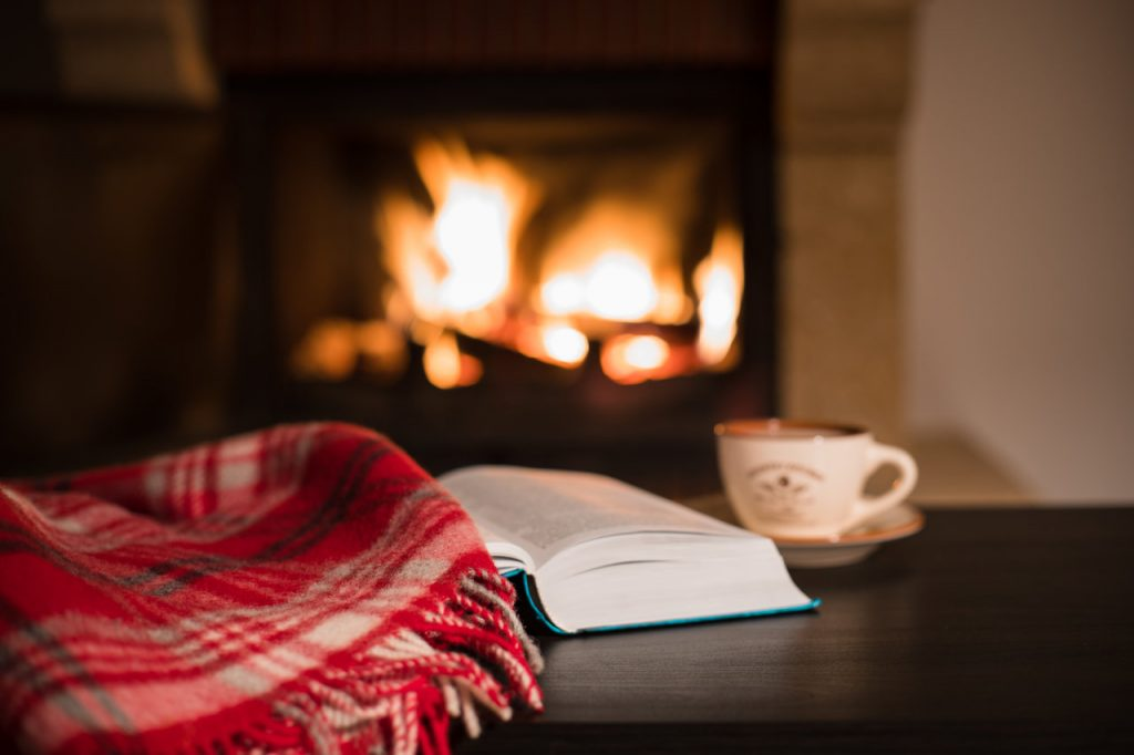 Open fire, blanket, book.