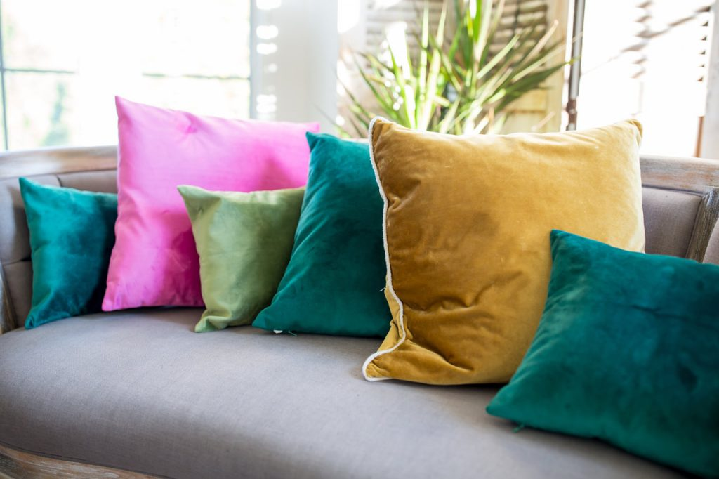 Grey Sofa with assorted jewel tone pillows