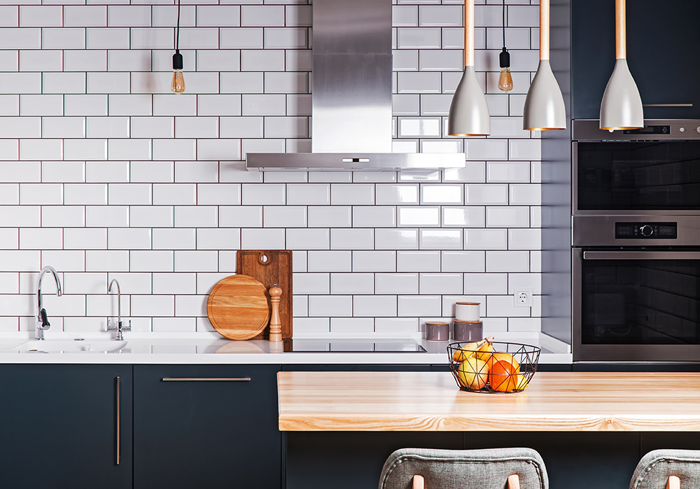Blue kitchen with white metro tiles