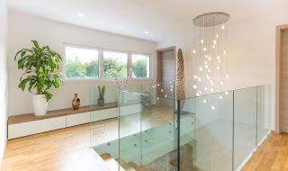 Modern glass banisters and modern lighting