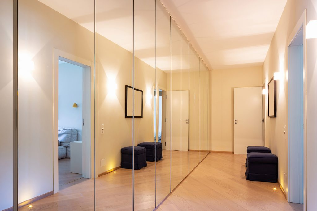 Mirrors and lighting to brighten hallway