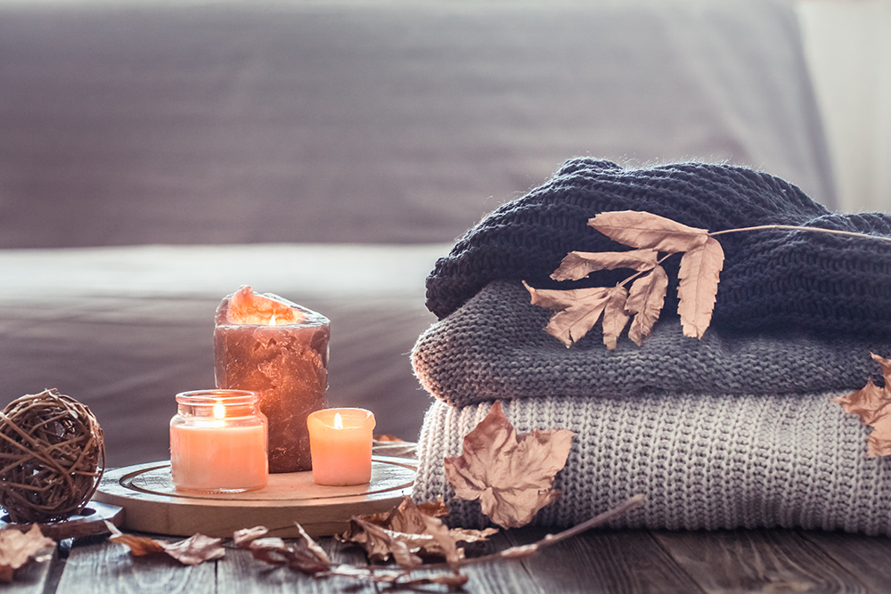 Cozy autumn with candles and a sweater