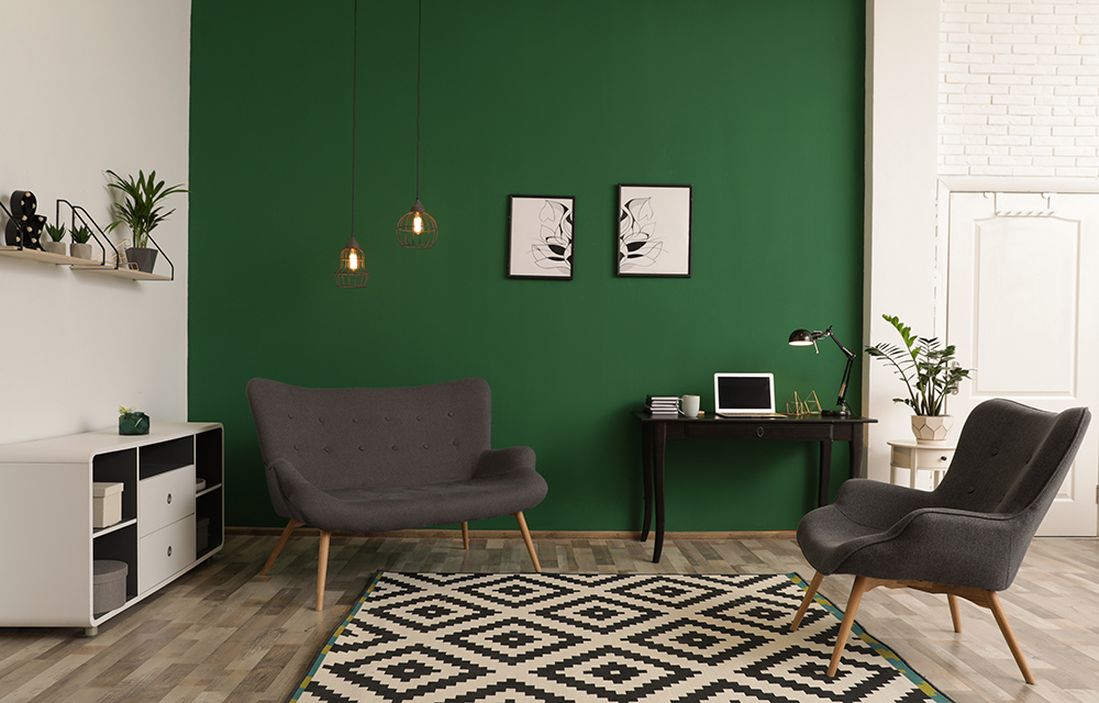 Green living room with grey chairs and vinyl flooring