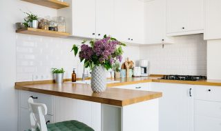 White kitchen cabinets with wooden worktops