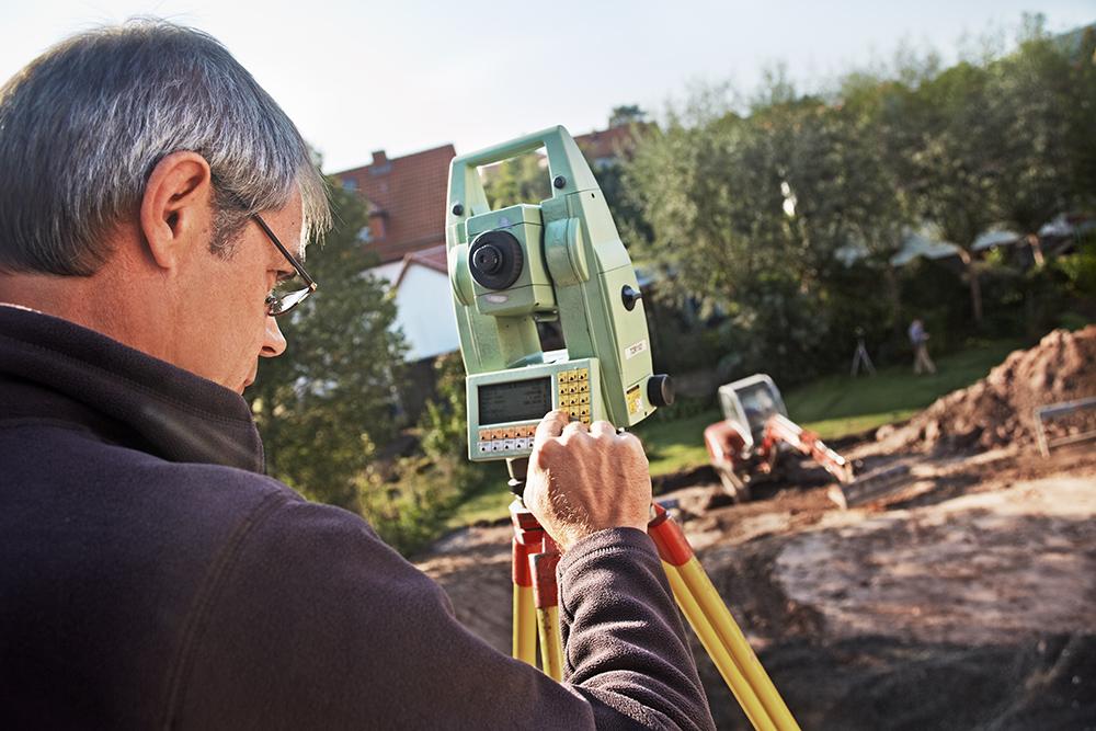 Lland surveyor, geodesist at work