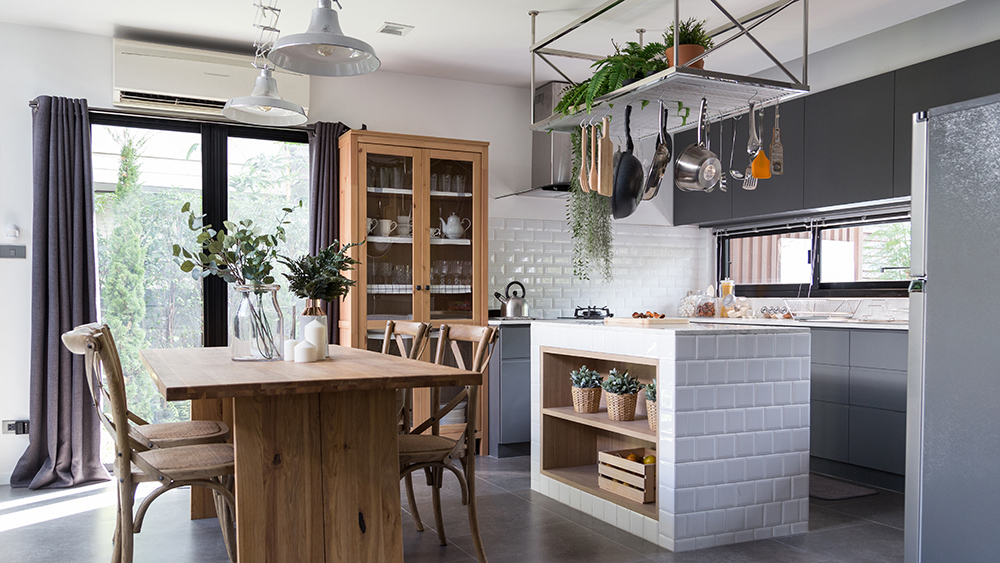 White and wooden kitchen with clever hanging storage area