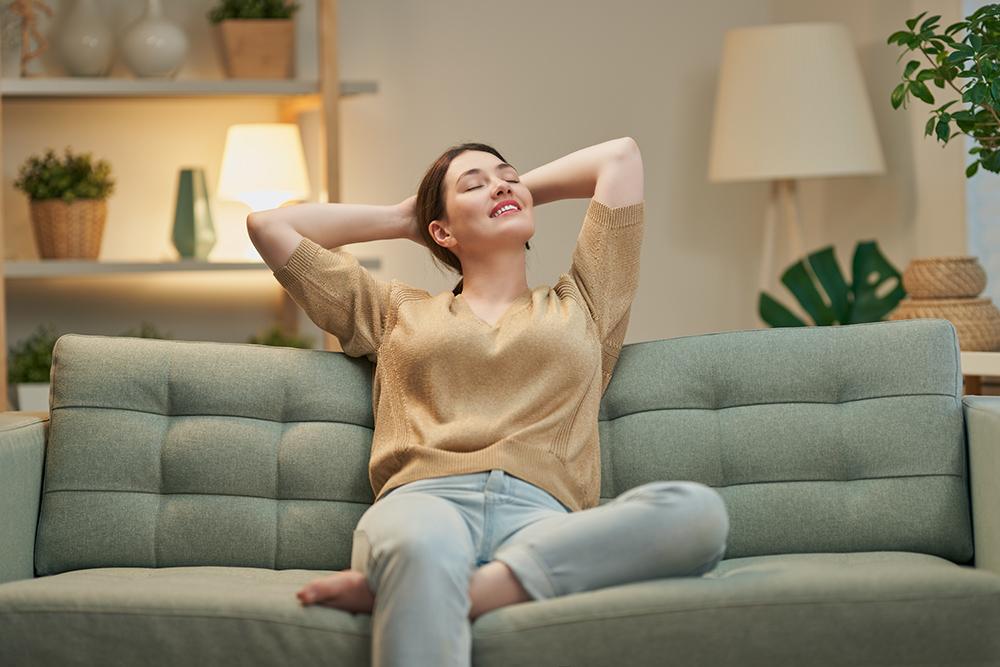 Women relaxing on sofa