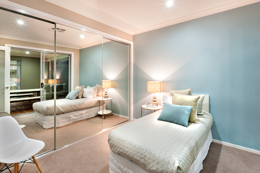 Small bedroom with built in glass wardrobe