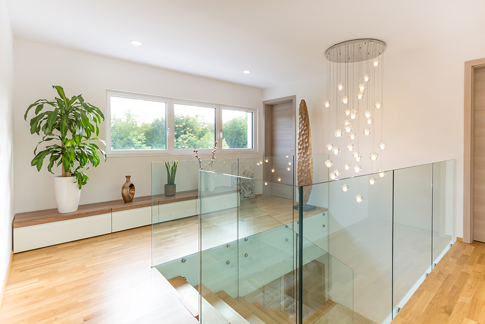 Glass banisters with long hanging Chandelier