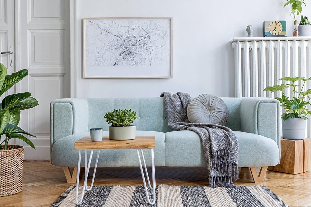 Scandinavian living room with sylish column radiator