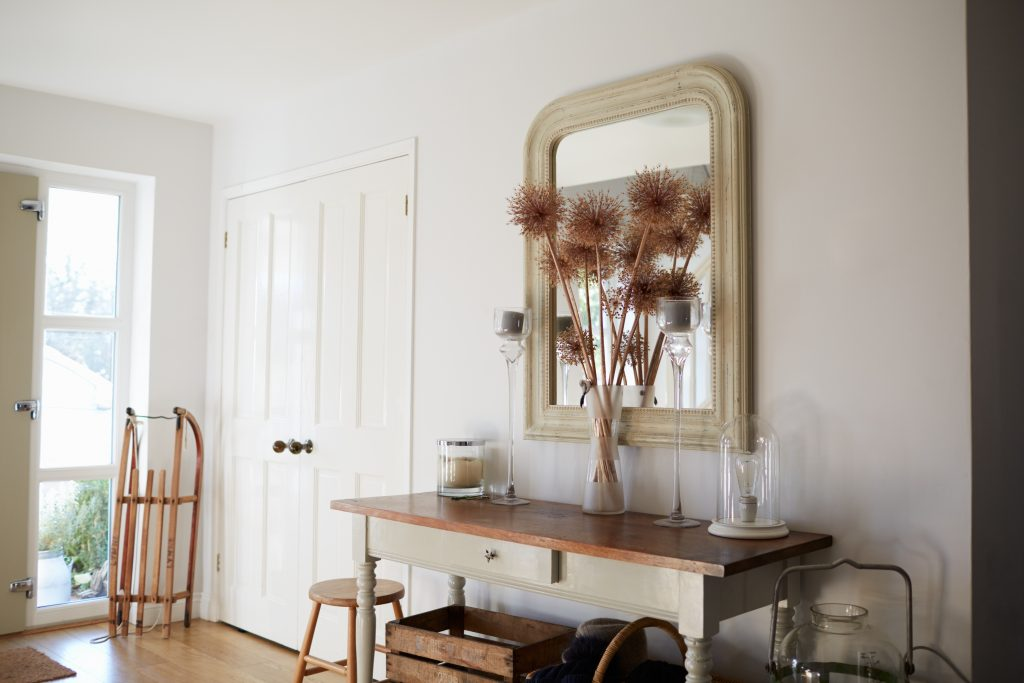 Bright open entrance hall. White and neutral tones