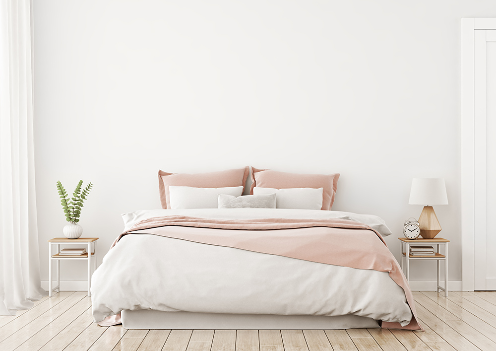 Peaceful, relaxing bedroom with white and pastal pink.