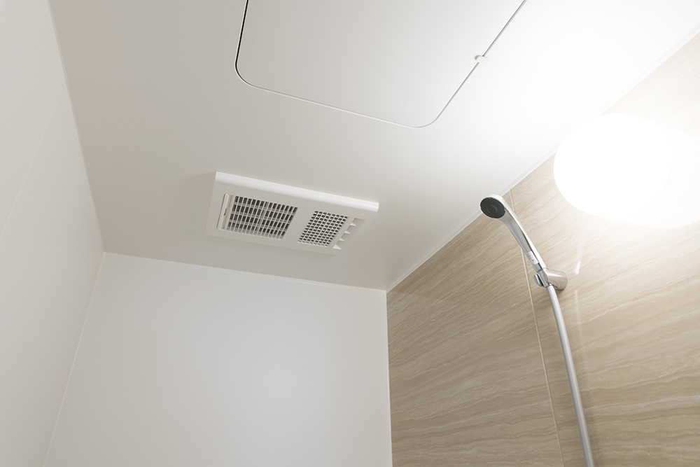 Bathroom with shower and air vent.