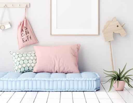 Thick blue childs mattress with pink pillow