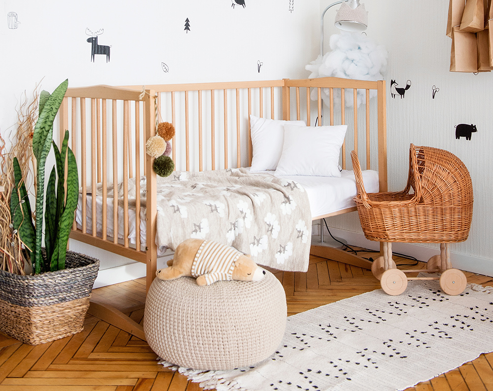 Childs bedroom with wooden cot